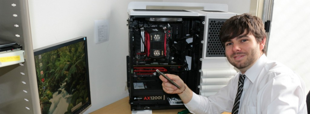 Computer Repair Tech With Open PC Tower