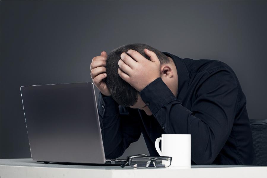 man with broken laptop